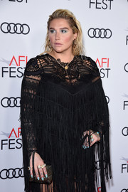 Kesha accessorized with a studded clutch by Loriblu at the AFI FEST premiere of 'On the Basis of Sex.'
