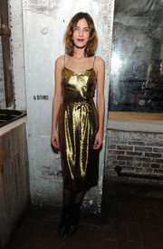 Alexa Chung got into the holiday spirit with this gold lamé slip dress by HVN for the HeForShe dinner.