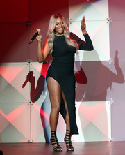Laverne Cox displayed an eye-popping amount of leg in this high-slit one-sleeve dress at the AHF World AIDS Day concert.