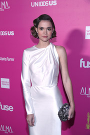 Maia Mitchell styled her white dress with an ornately beaded clutch for the ALMAs 2018.