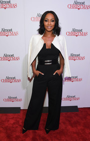 Keri Hilson slung a white tweed jacket over her shoulders for a smarter finish.