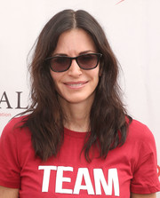 Courteney Cox sported a pair of classic wayfarers for some sun protection.