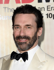 Jon Hamm attended Black & Red Ball wearing his hair slicked back and slightly messy at the top.