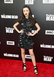 Christian Serratos complemented her dress with a pair of black ankle-tie sandals.