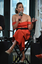 Paula Patton teamed printed d'Orsay pumps with an off-the-shoulder cutout jumpsuit for the AOL Build Speaker Series.