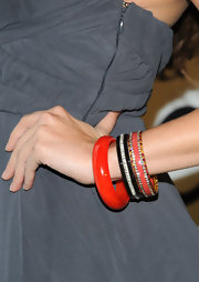 Jessica Lowndes spiced up her look with red bangle bracelets.