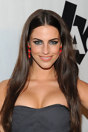 Actress Jessica Lowndes spiced up her strapless neckline with red dangle earrings.