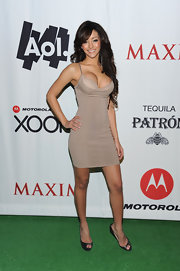 Melanie Iglesias wore a pair of black patent leather peep toe pumps at party hosted by 'Maxim.'