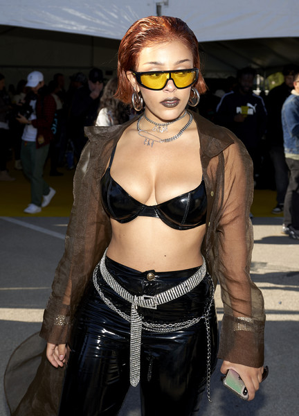 Doja Cat topped off her look with a pair of yellow shield sunglasses.