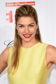 Jessica Hart's red lipstick made a beautiful contrast to her yellow dress.