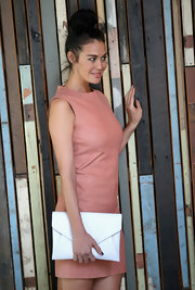 Megan Gale's white envelope clutch and coral leather dress at the ASTRA Awards finalists announcement were a simple yet sophisticated pairing.