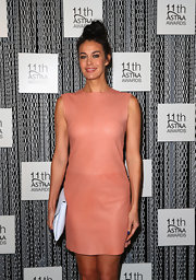 Megan Gale went for a no-frills look with this sleeveless coral leather dress at the ASTRA Awards finalists announcement.