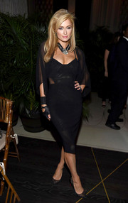 Paris Hilton complemented her dress with beaded black mesh pumps by Christian Louboutin.