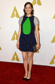 Marion Cotillard showed up to the Academy Awards Nominee Luncheon in a stunning dress with sequinned sleeves.