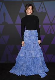 Kathryn Hahn turned heads in a Rosie Assoulin combo gown, featuring a turtleneck top and a voluminous tiered skirt, at the 2018 Governors Awards.