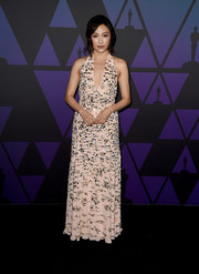 Constance Wu attended the 2018 Governors Awards wearing a crystal-adorned halter gown by Miu Miu.