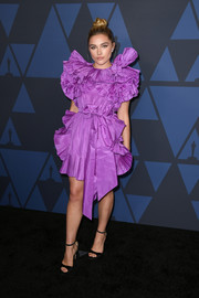 Florence Pugh sealed off her look with a pair of black ankle-strap sandals.