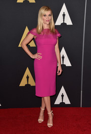 Reese Witherspoon chose a simply sophisticated Ralph Lauren sheath dress in a delightful magenta hue for the Governors Awards.