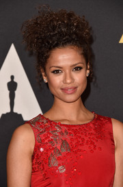 Gugu Mbatha-Raw went for playful glamour with these messy-chic pinned-up curls at the Governors Awards.