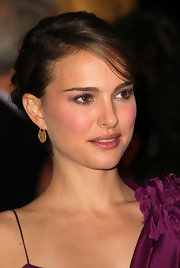 Actress Natalie Portman attended the Academy of Motion Pictures Arts & Sciences 2nd Annual Governors Awards wearing 18-karat gold hoops with bezel set rose cut diamonds.