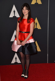 Zooey Deschanel finished off her look with quirky-glam fur-embellished pumps by Chanel.