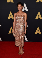Gugu Mbatha-Raw paired her dress with complementary ankle-strap sandals by Stuart Weitzman.