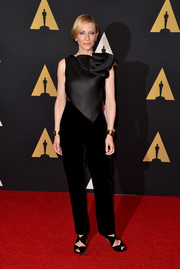 Cate Blanchett paired her top with high-waisted black velvet pants, also by Armani Prive.