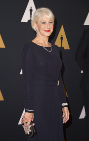 Helen Mirren attended the Governors Awards carrying a bejeweled satin clutch.