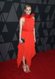 Diane Kruger coordinated her dress with strappy red heels.