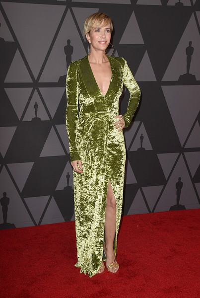 Kristen Wiig looked radiant in an avocado-green velvet wrap dress by Galvan at the Governors Awards.