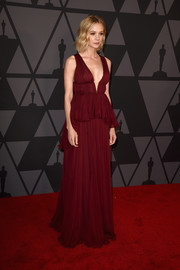 Carey Mulligan glammed it up in a cherry-red empire gown by Giambattista Valli Couture at the Governors Awards.