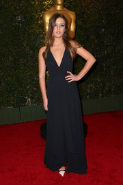 Adele Exarchopoulos showed a bit of sexiness at the Governors Awards in a navy evening dress with a deep-V neckline.