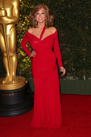 Raquel Welch totally wowed in a curve-hugging red off-the-shoulder dress during the Governors Awards.