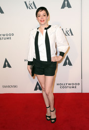 Rose McGowan teamed a black-and-white ruffle-neckline blouse with a pair of black shorts for her red carpet look during the Hollywood Costume Opening Party.