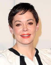 Rose McGowan made her kissers pop with a swipe of bright orange lipstick.