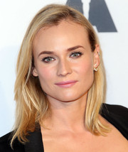 Diane Kruger kept her beauty look subtle and sweet with pink lipstick.
