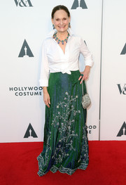 Beth Grant polished off her red carpet look with a beaded silver purse.