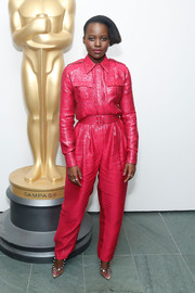 Lupita Nyong'o donned a fuchsia Bande Noir blouse with military pockets for the official Academy screening of 'Us.'