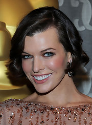 Milla Jovovich attended the Academy of Motion Picture Arts and Sciences' Scientific and Technical Awards wearing her layered bob in shiny waves.