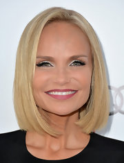 Kristin opted for a mauvey pink lipstick to complement her rosy skin tone.