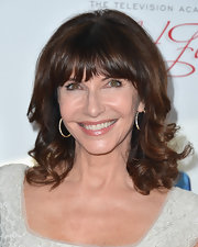 Mary Steenburgen opted for a more glamorous 'do with these shoulder length curls and thick, blunt bangs.