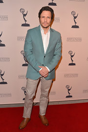 Nick Wechsler added some color to his red carpet look with a sea foam blazer.