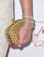 Mary Steenburgen added just a touch of bling to her red carpet look with these five gold bangles.