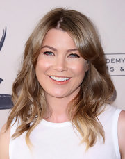 Ellen Pompeo wore her highlighted tresses in long layered waves with lengthy side-swept bangs while attending an Evening With Shonda Rhimes and Friends.