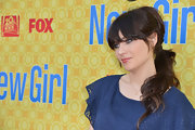 Zooey Deschanel attended a screening of 'New Girl' wearing her shiny tresses in a low ponytail with long bangs.