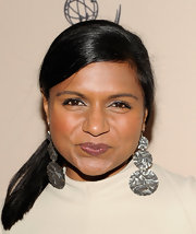 Mindy paired her sleek ponytail with multiple circle earrings.