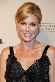Julie Bowen's updo is a more casual version of the classic bun. To try her look, collect hair into a ponytail at the nape of the neck, twist loosely and wrap, securing the perimeter of the bun with bobby pins.