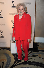 Betty White looked ultra-chic in a red suit that was embellished on the bodice.