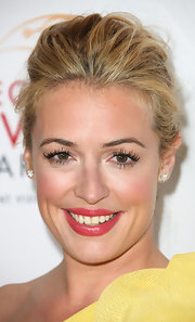 Cat Deeley wore her hair swept back in a casual updo for the College Television Awards.