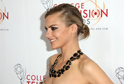 Eliza Coupe attended the College Television Awards wearing her hair drawn tightly back and styled in a loose bun.
